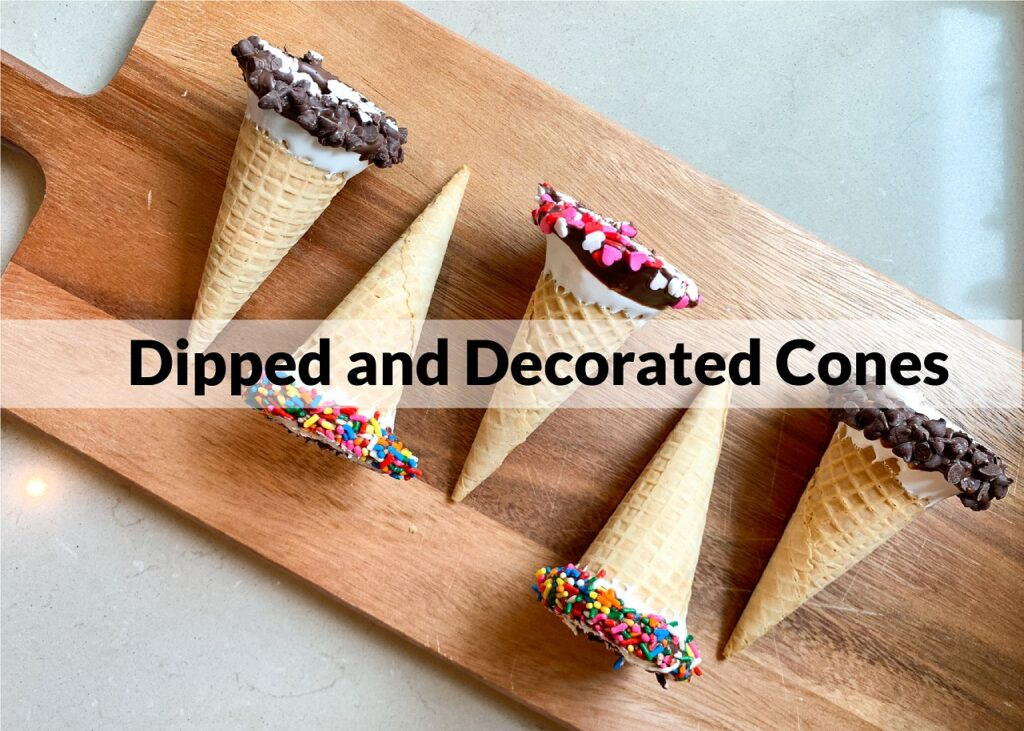 decorated ice cream cones lined on a cutting board