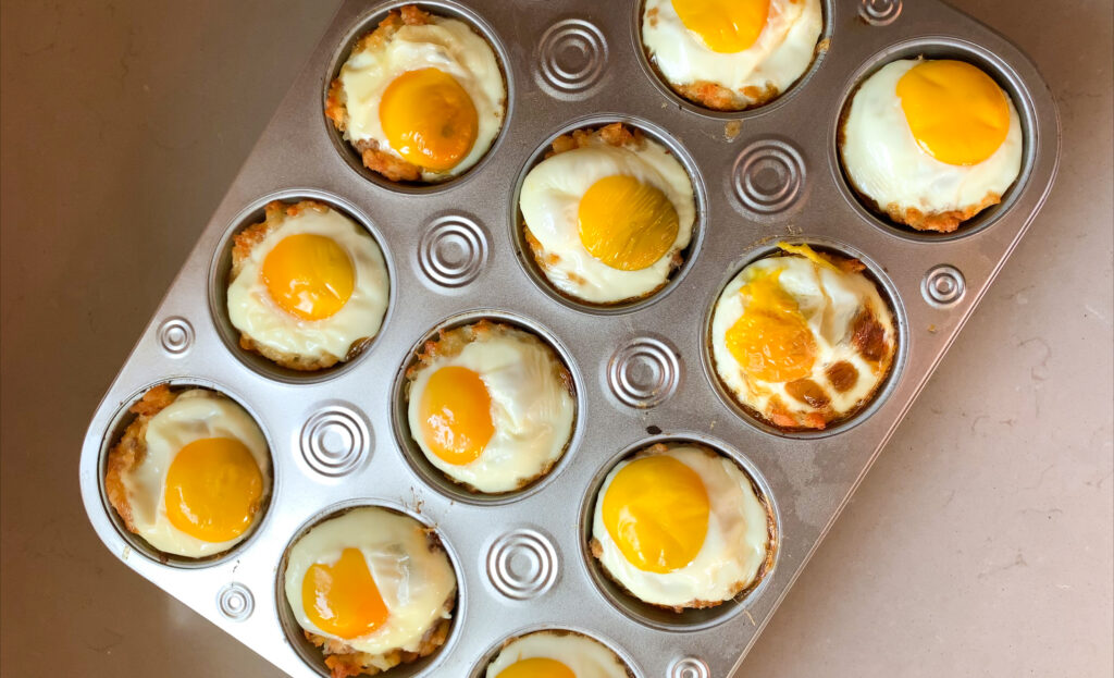 baked breakfast tot cups in muffin tin