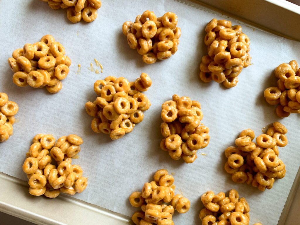 peanut butter cereal bites on parchment lined baking sheet